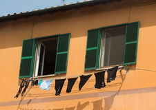 Underwear drying on the rope in Italy Royalty Free Stock Photo