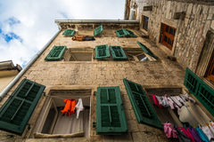 Underwear drying on the rope in the old yard in Montenegro, Europe Royalty Free Stock Image