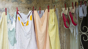 Underwear and shoes drying on rope Stock Photography