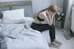 Underweight red hair woman Stock Photography