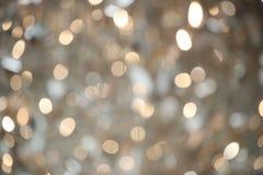 Undeutlicher Hintergrund des abstrakten goldenen Funkelns Stockfoto