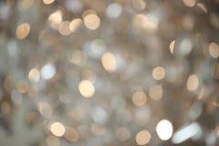 Undeutlicher Hintergrund des abstrakten goldenen Funkelns Stockbild