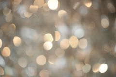 Undeutlicher Hintergrund des abstrakten goldenen Funkelns Stockfotografie