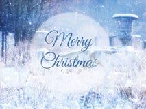 Undeutliches und abstraktes magisches Winterlandschaftsfoto mit Grußtext: Frohe Weihnachten Funkelnüberlagerung Lizenzfreies Stockfoto