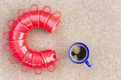 Undici tazze impilate sotto forma della lettera C Fotografia Stock