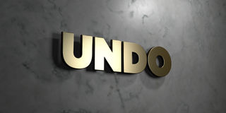 Undo - Gold sign mounted on glossy marble wall  - 3D rendered royalty free stock illustration Stock Image