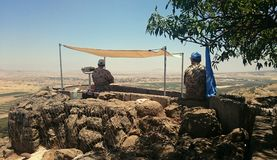 UNDOF UN Observers on Mount Bental. Two United Nations Disengagement Observer Force (UNDOF) soldiers from Norway observing (with binoculars) the border between Stock Photo