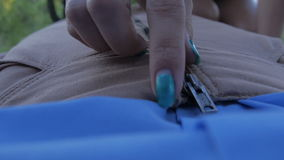 Undoing and Zipping up the Zipper on a Woman's Skirt stock video