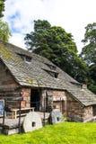 Undre Alderley Mill är en århundradewatermill för th 16 Arkivbilder