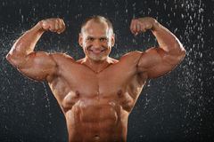 Undressed bodybuilder shows muscles Stock Photography