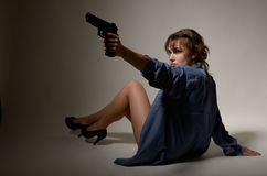 Undressed girl with a handgun Royalty Free Stock Photography