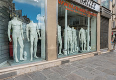 Undressed male mannequins in Paris store window Stock Photos