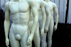 Undressed mannequins. Making a line Stock Photos
