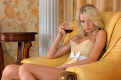 Undressed woman with glass of wine in luxury inter Royalty Free Stock Photography