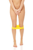 Undressed woman holding her crotch. Stock Image
