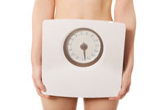 Undressed woman with scale. Stock Photos