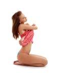 Undressing ragazza in vestito rosso Fotografia Stock Libera da Diritti