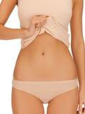 米黄棉花undrewear的妇女身体 免版税库存图片