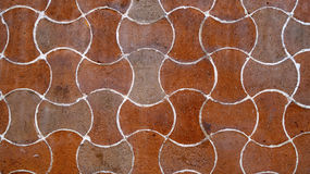 Undulated waves orange bricks wall or floor texture background Royalty Free Stock Images