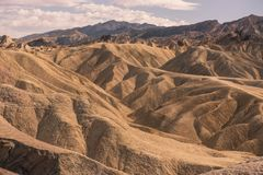 The undulating landscape of Death Valley. Is the focus of this picture taken in the summer, with clouds in the sky stock images