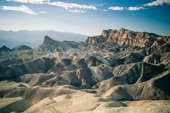 The undulating landscape of Death Valley. The undulating rock formation of the Death Valley in Arizona is the focus of this picture taken in the summer stock photos