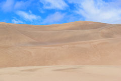 Undulating Sand Dunes and Blue sky Stock Photos