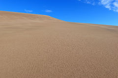 Undulating Sand Dunes and Blue sky Royalty Free Stock Image