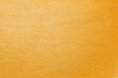 Undurchsichtiger gelber Hintergrund mit einem Licht flockig Stockfoto
