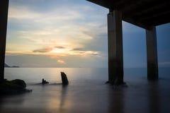 Undwe the bridge. Blue sea under the bridge with sunset scene stock photos