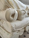 Fabric. Rolls of knitted fabric awaiting dyeing & makeup into garments Royalty Free Stock Photo