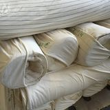 Cotton Fabric. Rolls of knitted cotton and polyester fabricin its raw state  awaiting dyeing Stock Photography