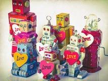 Une équipe de robots d'amour modifiés la tonalité Photo libre de droits