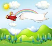 Une équitation de singe dans un avion rouge avec une bannière vide Photos libres de droits