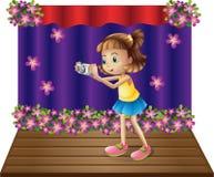 Une étape avec une jeune fille tenant un appareil-photo illustration stock