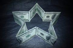 Une étoile de 100 billets d'un dollar Image stock
