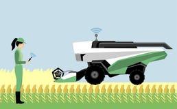 Une agricultrice commande une moissonneuse de cartel autonome illustration libre de droits