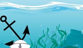 Une ancre et un chapeau de marin submergés au fond de l'océan Image stock
