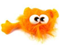 Une bête orange avec de grands yeux image libre de droits