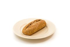 Une baguette d'un plat blanc cassé Photographie stock libre de droits