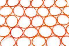 Une bande élastique rouge Images stock