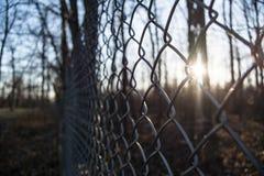 Une barrière au coucher du soleil Photo stock