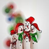 Une belle famille tirée par la main et doigt des bonhommes de neige Photographie stock