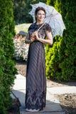 Une belle fille dans une robe photographie stock