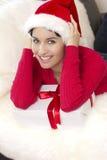 Une belle fille sexy est les prises de sourire par cadre de cadeau Photo stock