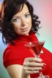 une belle jeune femme avec Martini Photos stock