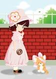 Une belle petite fille et un chat mignon Photographie stock libre de droits