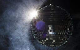 Une bille de disco avec l'épanouissement léger Photographie stock libre de droits