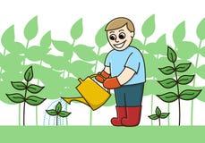 Une boîte d'arrosage de Watering Plants With A de jardinier Image stock
