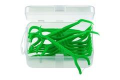 Une boîte de flossers dentaires verts (sélection de soie) Images stock
