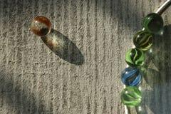 Une boule en verre et une paire de boules en verre photographie stock libre de droits